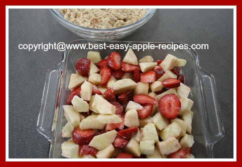 Making an Apple Crumble with Strawberries for Dessert