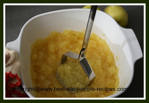 Mashing Apples to Make Applesauce