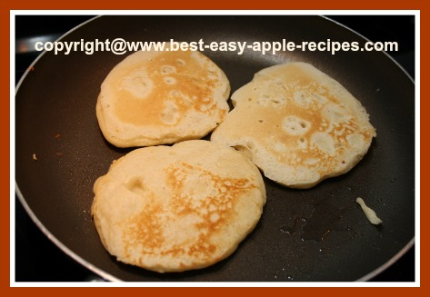 Frying Pancakes with Apples